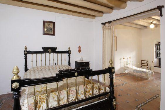 Federico García Lorca's Birthplace-Museum in Fuente Vaqueros. Federico's parents' bedroom and his cradle in the background.