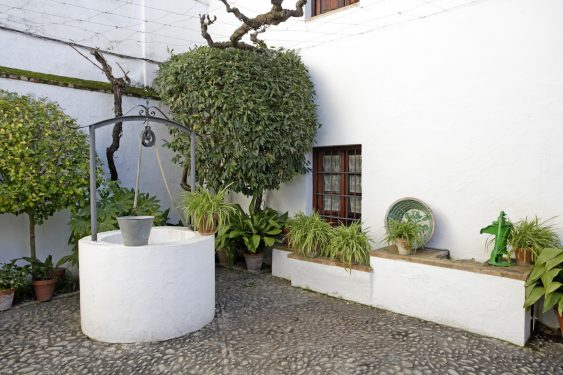 Birthplace Museum of Federico García Lorca in Fuente Vaqueros. Corner of the patio with the well.